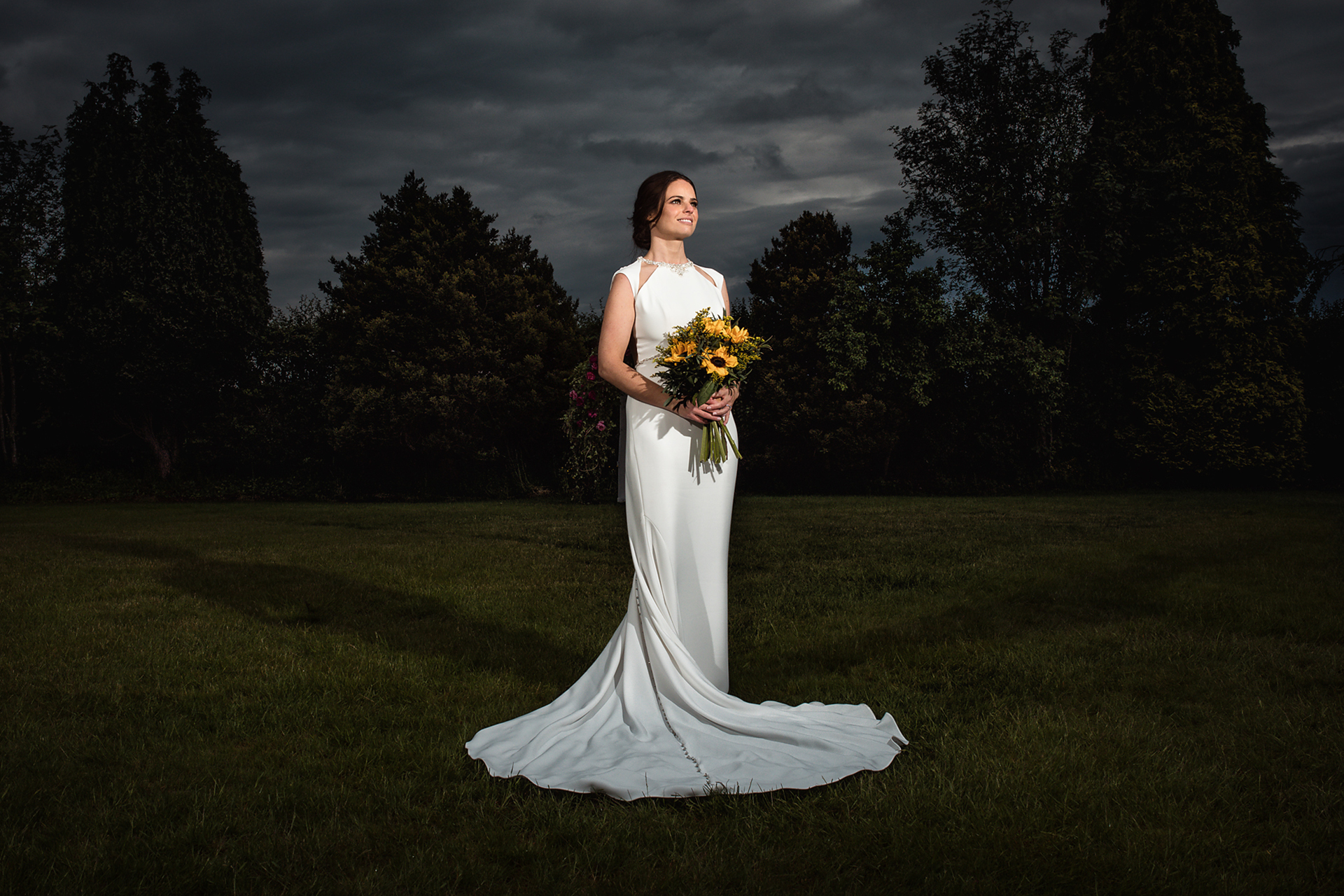 The bride standing outside holding a bouquet