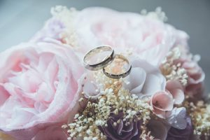 Wedding rings displayed with flowers