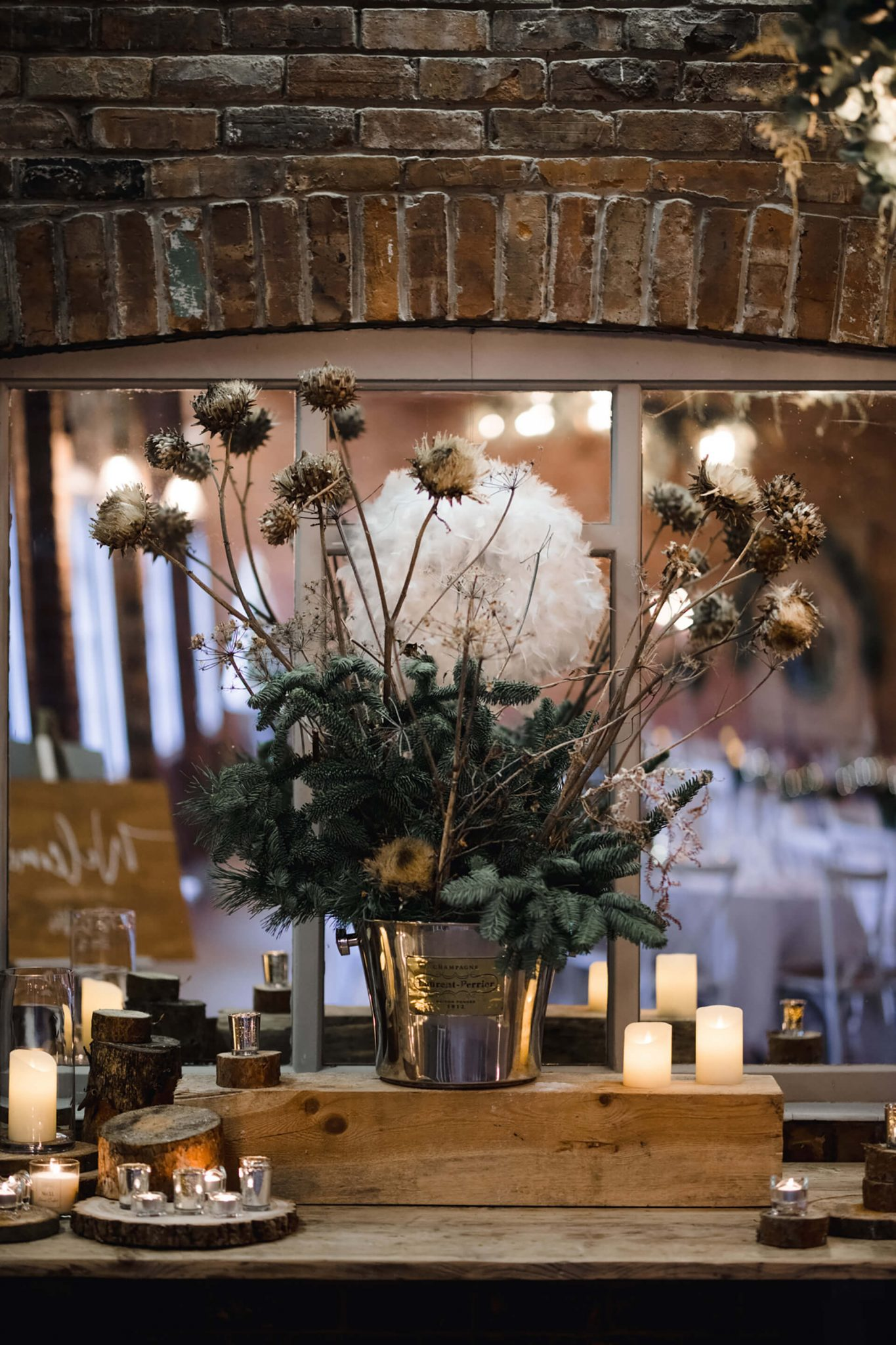 Christmas wedding decorations with logs and tealights